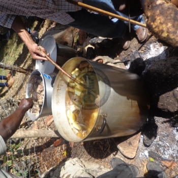 The cooking of the sacred meal for the ancestors is traditionally carried out by males as in this image.jpg