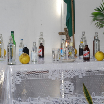 Table with Glass Bottles, Candle, Grapefruit.JPG
