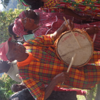 Playing the drum under the Kindah Tree.JPG
